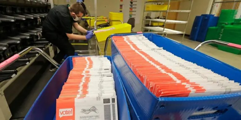 Aug. 5, 2020: Vote-by-mail ballots are shown in sorting trays at the King County Elections headquarters in Renton, Wash. (AP Photo/Ted S. Warren)