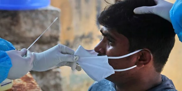 A health worker takes a nasal swab sample to test COVID-19 on Sunday, September 13, 2020 in Hyderabad, India.  India's coronavirus cases are now second in the world and second only to the United States.  (AP Photo / Mahesh Kumar A.)