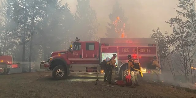 This photo provided by the Unified Fire Authority shows Utah fire crews prepare to fight wildfires near Butte Falls in southern Oregon on Saturday, Sept. 12, 2020. (Matthew McFarland/Unified Fire Authority via AP)