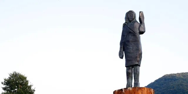 A bronze statue representing the U.S first lady Melania Trump made by Brad Downey, a Berlin-based U.S. artist, is erected in her birthplace of Sevnica, Slovenia, Tuesday, Sept. 15, 2020, after a previous one, made in wood, was set alight. Melania Trump was born and grew up in Slovenia before moving abroad as a fashion model. (AP Photo)