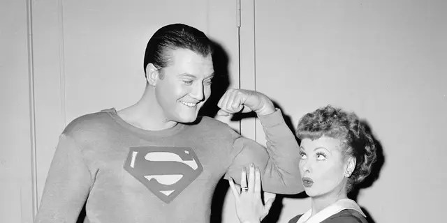 American actor George Reeves (1914-1959) (in Superman costume) flexes his bicep while actress and comedian Lucille Ball (1911-1989) (as Lucy Ricardo) touches his muscle during the episode 'Lucy and Superman' of Ball's sitcom series 'I Love Lucy,' Hollywood, Calif., Nov. 15, 1956.