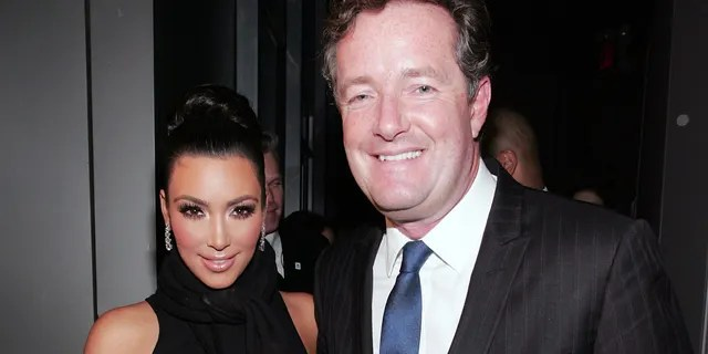 Kim Kardashian and Piers Morgan celebrate Kim Kardashian's appearance on 'The Apprentice' in 2010.