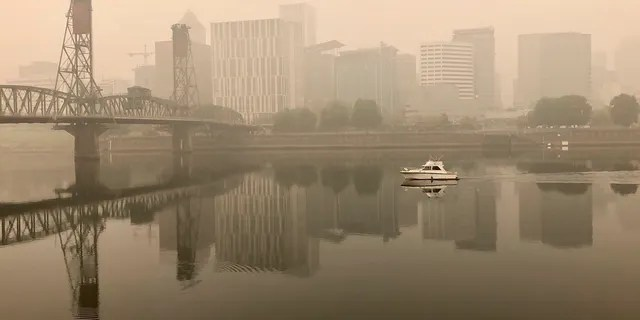 A view of downtown Portland from the East Bank Esplanade on Monday, Sept. 14, 2020. The entire Portland metropolitan region remains under a thick blanket of smog from wildfires that are burning around the state, and residents are being advised to remain indoors due to hazardous air quality.