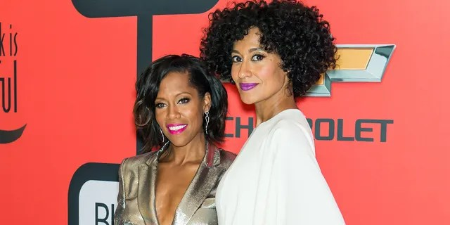 Actresses Regina King (L) and Tracee Ellis Ross. (Photo by Gilbert Carrasquillo/FilmMagic)