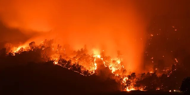 Smoke billows into the sky as the Glass Fire burns in the hills of Calistoga, Calif., on Monday, Sept. 28, 2020.