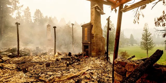 A chimney stands, Monday, Sept. 28, 2020, at the Restaurant at Meadowood, which burned in the Glass Fire, in St. Helena, Calif.
