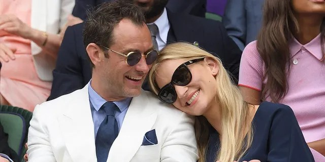 Jude Law and Phillipa Coan attend day eleven of the Wimbledon Tennis Championships at Wimbledon on July 08, 2016 in London, England.