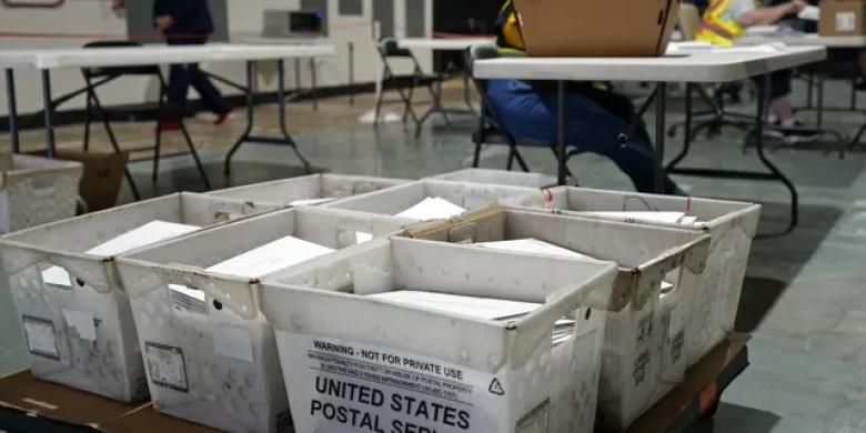 FILE - In this Sept. 3, 2020, file photo, workers prepare absentee ballots for mailing at the Wake County Board of Elections in Raleigh, N.C. (AP Photo/Gerry Broome)