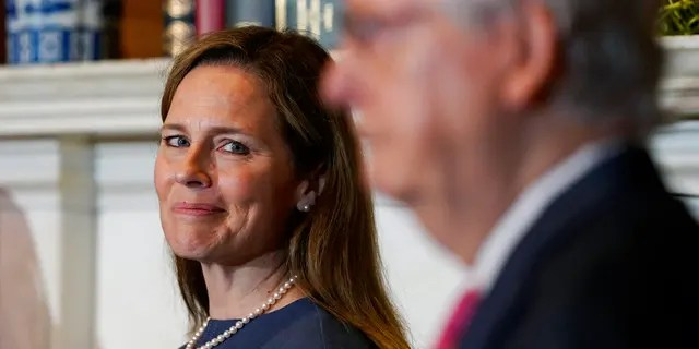 Supreme Court nominee Judge Amy Coney Barrett looks over to Senate Majority Leader Mitch McConnell of Ky., as they meet with on Capitol Hill in Washington, Tuesday, Sept. 29, 2020. (Associated Press)