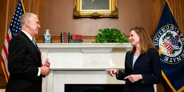 Sen. Thom Tillis, R-N.C., meets with Judge Amy Coney Barrett, President Donald Trump's nominee to the Supreme Court, at the U.S. Capitol, Sept. 30, 2020, in Washington. (Associated Press)