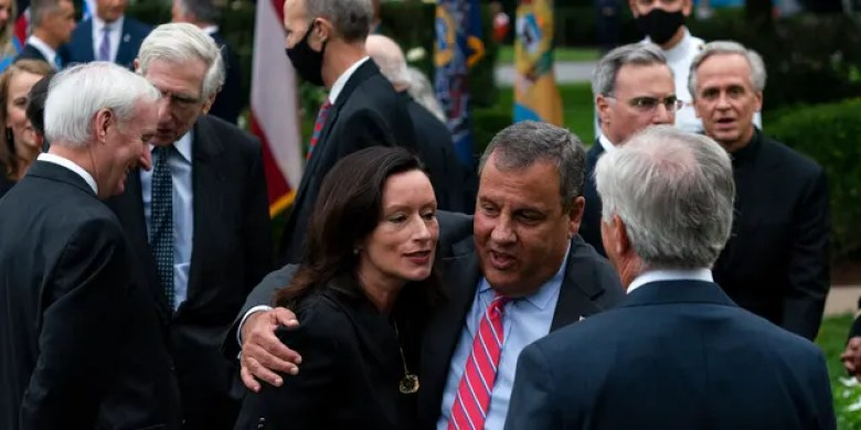 In this Saturday, Sept. 26, 2020, photo former New Jersey Gov. Chris Christie, front second from right, speaks with others after SCOTUS nomination. Notre Dame President Father John Jenkins stands at back right. (AP Photo/Alex Brandon)