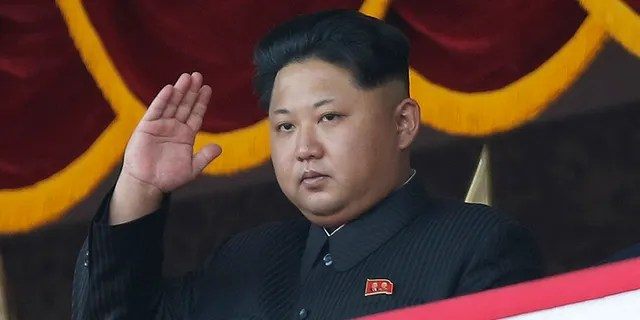 North Korean leader Kim Jong Un gestures as he watches a military parade during celebrations to mark the 70th anniversary of North Korea's Workers' Party in Pyongyang, North Korea, Oct. 25, 2015. (Associated Press)