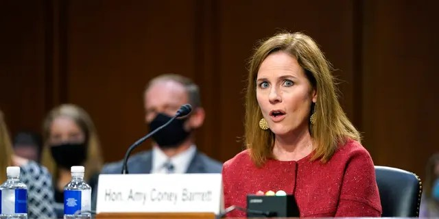 Supreme Court Justice Amy Coney Barrett speaks during a confirmation hearing before the Senate Judiciary Committee, Tuesday, Oct. 13, 2020, on Capitol Hill in Washington. Barrett spoke at the University of Louisville's McConnell Center on Sunday. (AP Photo/Patrick Semansky, Pool)