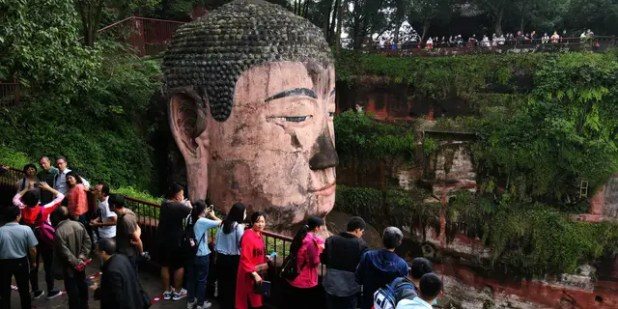 On the first day of the eight-day National Day holiday on October 1, tourists visit the UNESCO World Heritage Site Leshan Giant Buddha.  (Getty Images by Liu Zangjang Jun / China News Service)