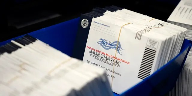 Mail-in ballots for the 2020 General Election in the United States are seen after being sorted at the Chester County Voter Services office, Friday, Oct. 23, 2020, in West Chester, Pa. (AP Photo/Matt Slocum)