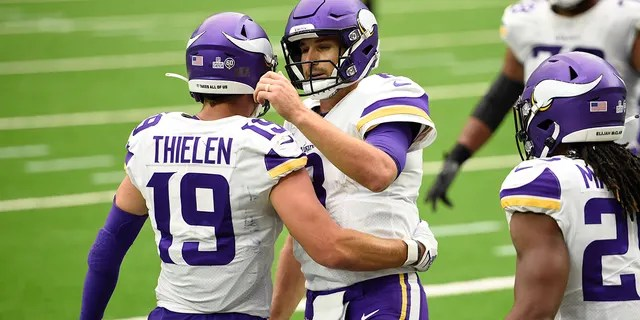 Minnesota Vikings wide receiver Adam Thielen (19) and Minnesota Vikings quarterback Kirk Cousins (8) celebrate after they conned on a pass for a touchdown against the Houston Texans during the second half of an NFL football game Sunday, Oct. 4, 2020, in Houston. (AP Photo/Eric Christian Smith)