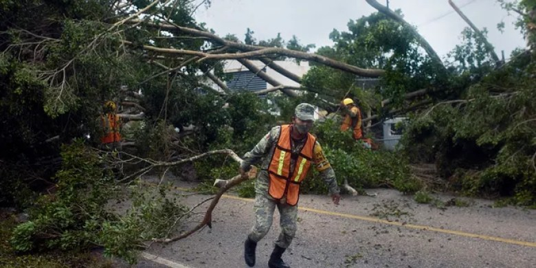 Soldiers clear trees toppled by Hurricane Delta in Tizimin, Mexico, Wednesday, Oct. 7, 2020.