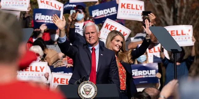 Vice President Mike Pence and Sen. Kelly Loeffler wave to the crowd during a Defend the Majority Rally, Friday, Nov. 20, 2020 in Canton, Ga. (Associated Press)