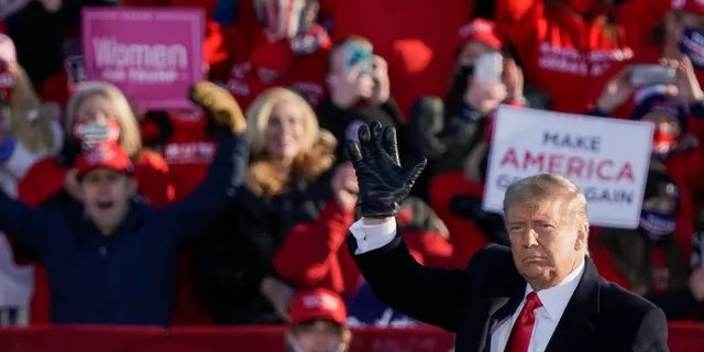 President Trump acknowledges the crowd after speaking at a campaign rally Friday, Oct. 30, 2020, at the Austin Straubel Airport in Green Bay, Wis. (AP Photo/Morry Gash)