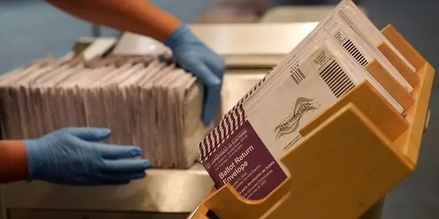 In this Nov. 1, 2020, file photo, envelopes containing ballots are shown at a San Francisco voting center. (AP Photo/Jeff Chiu, File)