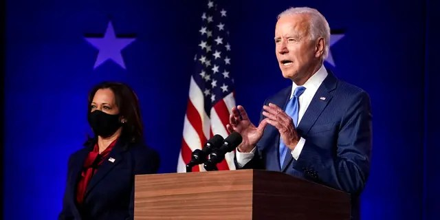 Democratic vice presidential candidate Sen. Kamala Harris, D-Calif., listens as Democratic presidential candidate former Vice President Joe Biden speaks Friday, Nov. 6, 2020, in Wilmington, Del. (Associated Press)
