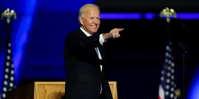 President-elect Joe Biden points to the crowd as he stands on stage after speaking Saturday, Nov. 7, 2020, in Wilmington, Del. (AP Photo/Andrew Harnik)