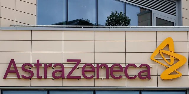 """FILE - In this Saturday, July 18, 2020 file photo a general view of AstraZeneca offices and the corporate logo in Cambridge, England. AstraZeneca says late-stage trials of its COVID-19 vaccine were """"highly effective'' in preventing disease. A vaccine developed by AstraZeneca and the University of Oxford prevented 70% of people from developing the coronavirus in late-stage trials, the team reported Monday Nov. 23, 2020.(AP Photo/Alastair Grant, File)"""