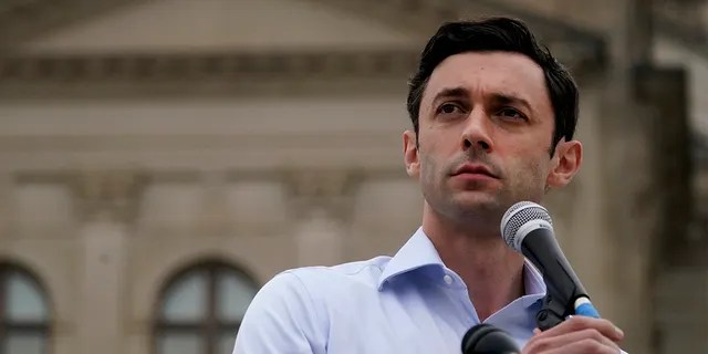Democratic candidate for U.S. Senate Jon Ossoff speaks during a news conference on Tuesday, Nov. 10, 2020, in Atlanta. He is facing Republican Sen. David Perdue, a top Trump ally, in a Jan. 5, 2021 runoff. (AP Photo/John Bazemore)