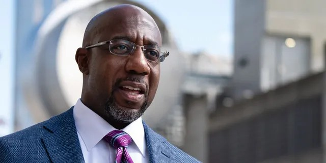 Sen. Raphael Warnock, D-Ga., speaks to the media after casting his ballot at State Farm Arena on October 21, 2020 in Atlanta, Georgia. Warnock beat former Sen. Kelly Loeffler, R-Ga., in a Jan. 5 runoff election to become Georgia's first Black senator. He's up for reelection in 2022. (Photo by Elijah Nouvelage/Getty Images)