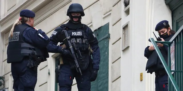 Police officers guard the scene in Vienna on Tuesday. (AP Photo/Matthias Schrader)