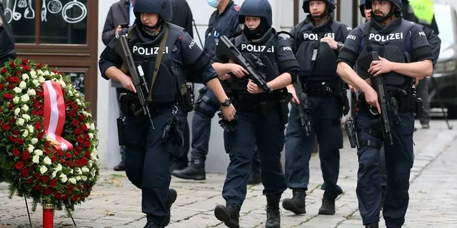 Armed police officers patrol on a street at the scene in Vienna, Austria, on Tuesday after a suspect shot and killed four people in a nightlife district, authorities said. Police in the Austrian capital said several shots were fired shortly after 8 p.m. local time on Monday. (Photo/Ronald Zak)