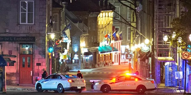 Police cars block the Saint-Louis Street near the Chateau Frontenac early Sunday, Nov. 1, 2020 in Quebec City, Canada.