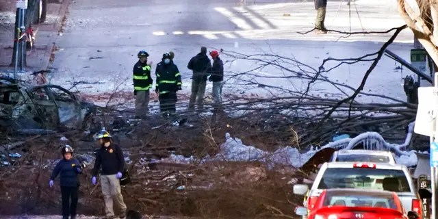 Investigators work at the scene of an explosion Saturday, Dec. 26, 2020, in Nashville, Tenn. The explosion that shook the largely deserted streets of downtown Nashville early Christmas morning shattered windows, damaged buildings and wounded three people. (AP Photo/Mark Humphrey)