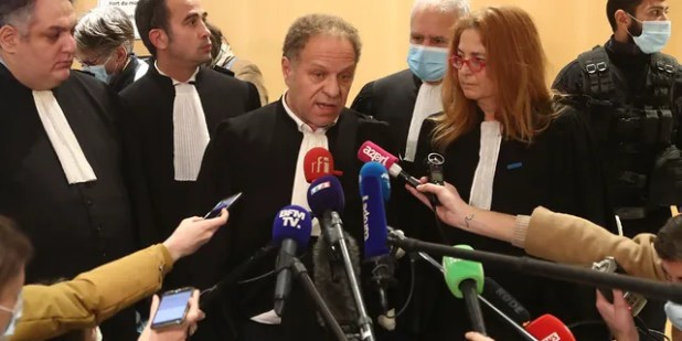 The plaintiff's lawyer, Mehana Mhow, the center responded to reporters after the January 2015 Paris attack trial decision, Wednesday, December, Dec.16, 2020, in Paris.  A fugitive widow of an Islamic State gunman and a man described as his rationalist on Wednesday was convicted of terrorism charges in a 14-person trial involving the January 2015 attacks in Paris against the satirical Charlie Hebdo newspaper and a kosher supermarket .  The verdict ends a three-month trial involving three days of murders in Paris, jointly claimed by the Islamic State group and al-Qaeda.  (AP Photo / Michelle Euler)