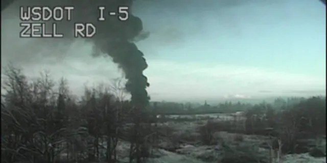 A train carrying crude oil derailed Tuesday and caught fire north of Seattle close to the Canadian border, authorities said.