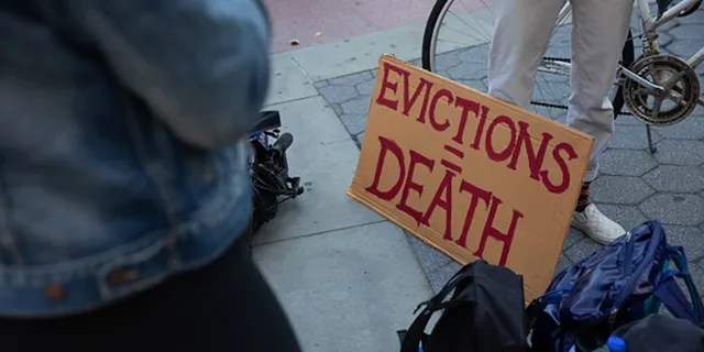 "A sign reads ""Evictions = Death"" during a protest in Foley Square in New York on Oct. 1, 2020. (Paul Frangipane/Bloomberg via Getty Images)"