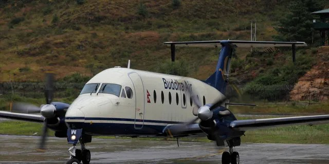 A Buddha Air Beechcraft 1900D aircraft taxis on the tarmac in Bhutan. On Dec. 18, a group of Buddha Air passengers probably weren't too happy to exit their domestic flight in Nepal – at the wrong airport. (Ed Jones/AFP via Getty Images)
