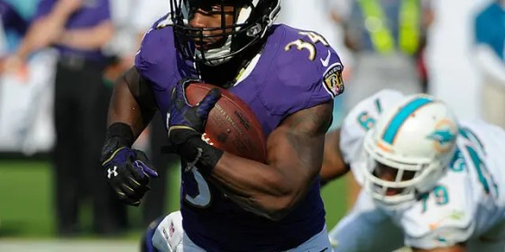 Baltimore Ravens runs back Lorenzo Taliaferro, 34, runs with the ball during an NFL football game against the Miami Dolphins at Sun Life Stadium in Miami Gardens, Florida, on December 7, 2014 (Getty Images)