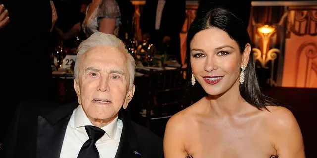 Kirk Douglas with his stepdaughter Catherine Zeta-Jones.  (Photo by Frazer Harrison / Getty Images for AFI)
