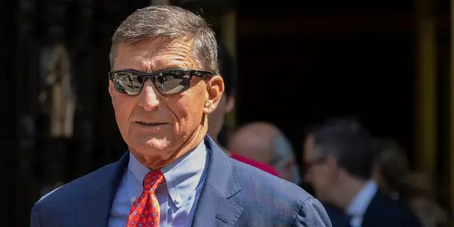 Michael Flynn, President Donald Trump's former national security adviser, leaves federal court in Washington, Tuesday, Sept. 10, 2019. (AP Photo/Manuel Balce Ceneta, file)