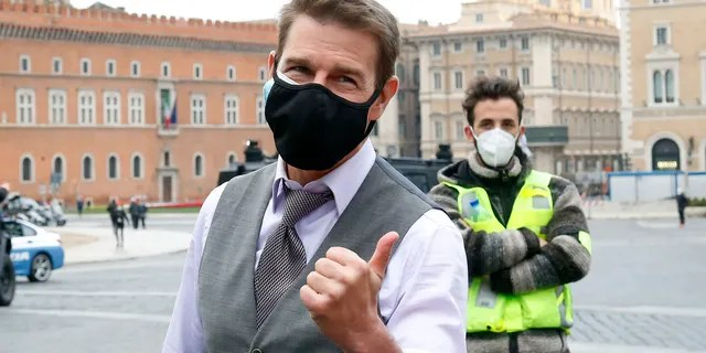 Actor Tom Cruise taking a selfie with his fans during a pause on the set of the film 'Mission: Impossible 7' in Piazza Venezia, just in front of the Victor Emmanuel II Monument (Tomb of the Unknown Soldier). Rome (Italy), November 29, 2020.