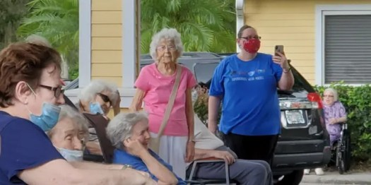 Photo of Rita Thomas (center) taken during her assisted living facility's drive-thru in August (Photo courtesy of the Thomas family).