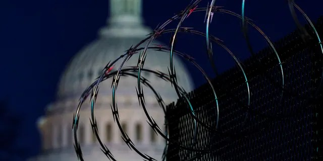 Riot fencing and razor wire reinforce the security zone on Capitol Hill in Washington, Tuesday, Jan. 19, 2021, before President-elect Joe Biden is sworn in as the 46th president on Wednesday. (Associated Press)