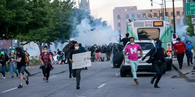 FILE: Detroit police fire tear gas at protesters during the third day of protesting police brutality and justice for George Floyd in Detroit.