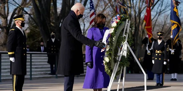 President Joe Biden and Vice President Kamala Harris participate in a wreath laying ceremony at the Tomb of the Unknown Soldier at Arlington National Cemetery in Arlington, Va. (AP Photo/Evan Vucci)