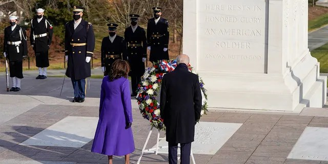 President Joe Biden and Vice President Kamala Harris lay a wreath at the Tomb of the Unknown Soldier at the Arlington National Cemetery, in Arlington, Va., Wednesday, Jan. 21, 2021. Joshua Roberts/Pool photo via AP)