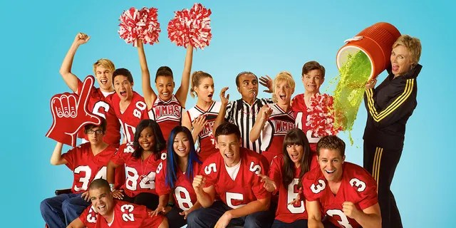 Naya Rivera (raised hands) starred in all six seasons of 'Glee.' (Photo by FOX Image Collection via Getty Images)