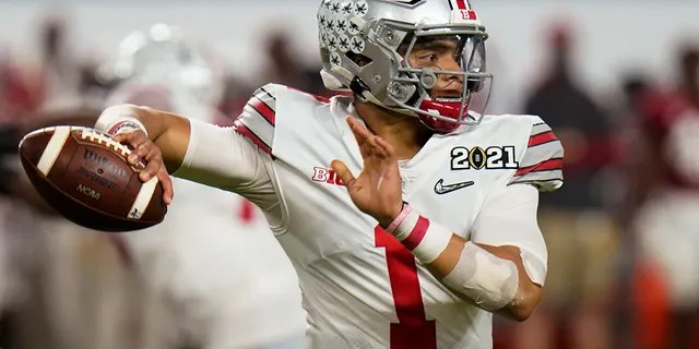 Ohio State quarterback Justin Fields passes against Alabama in the second half of an NCAA College Football Playoff National Championship game on Monday, Jan. 11, 2021, in Miami Gardens, Fla. (AP Photo / Chris O'Meara)