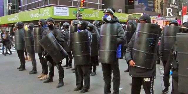 Antifa protesters carrying shields and wearing helmets marched through New York on Sunday.