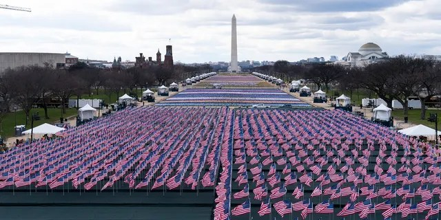 Flags are placed on the National Mall, looking towards the Washington Monument, and the Lincoln Memorial, ahead of the inauguration of President-elect Joe Biden and Vice President-elect Kamala Harris. (Associated Press)